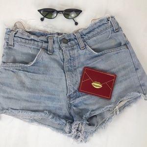 High waisted vintage destroyed Levi's jean shorts